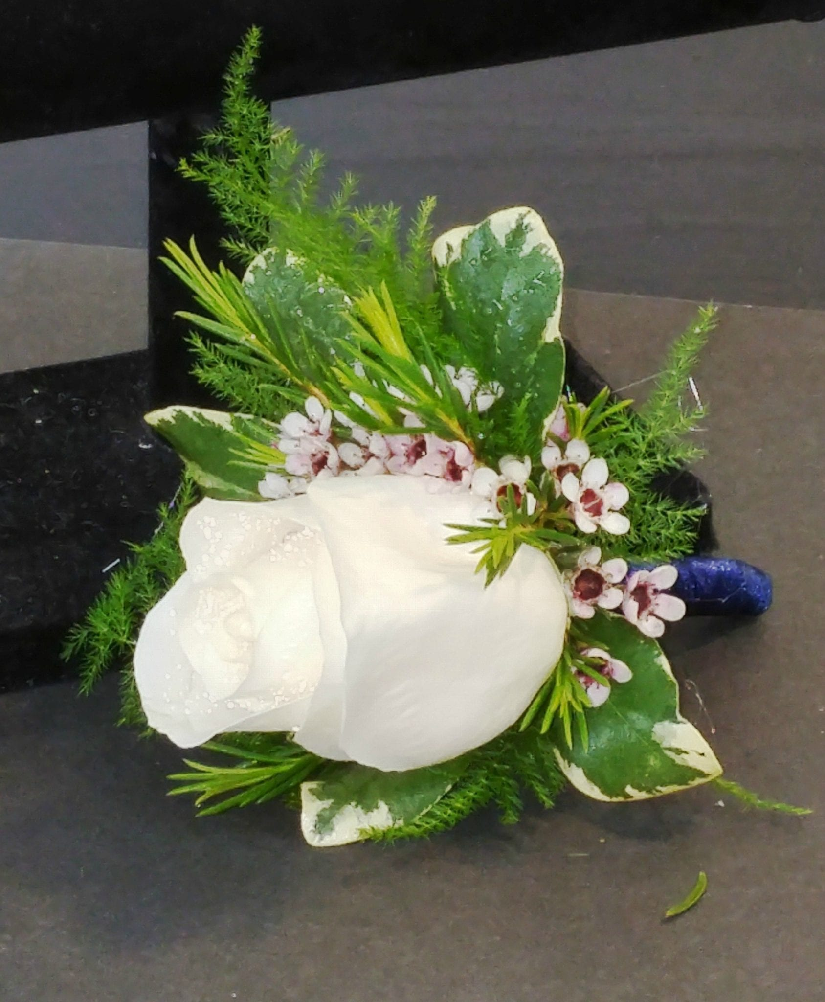 White Rose Boutonniere With Satin Ribbon Wrapped Stem Cb 705