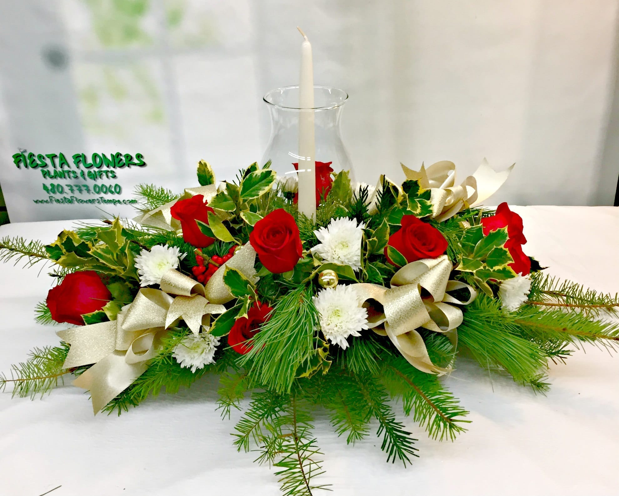 Christmas holly centerpiece h fiesta flowers