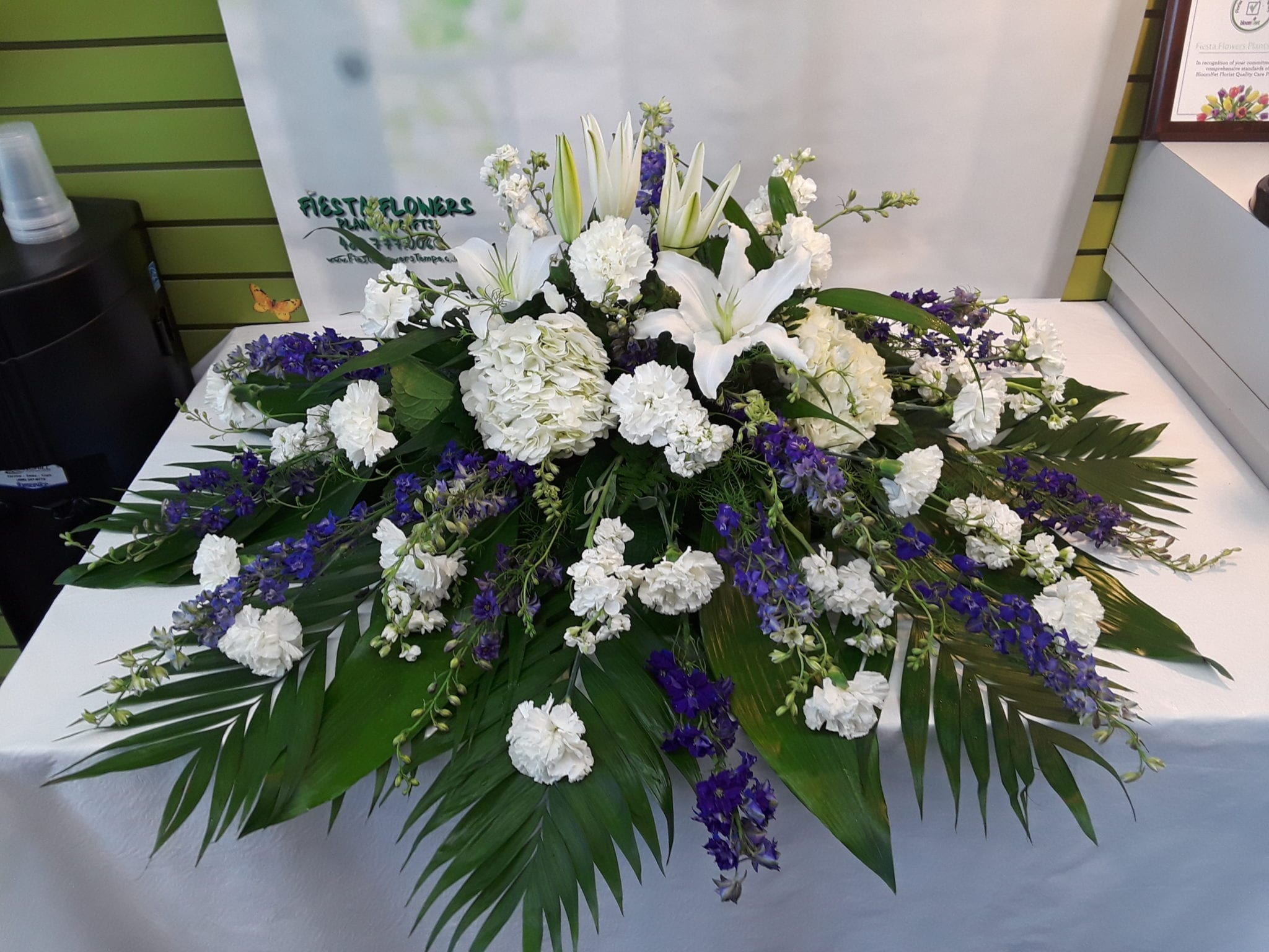 White lily tribute casket spray fc 309 fiesta flowers plants gifts white lily izmirmasajfo